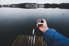 Shooting video by action camera. Heinolan, Finland Royalty Free Stock Photos