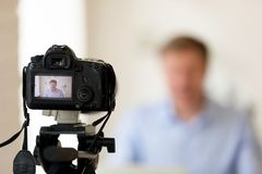 Shooting video or making photo using camera on tripod stock photo