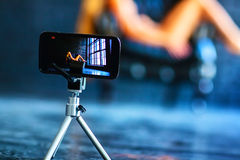 Shooting video. Modern mobile phone shooting video with model Stock Photography