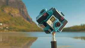 Shooting video of nature 360 degrees using six GoPro cameras. MAURITIUS - JUNE 17, 2016: Set of six GoPro cameras fixed on tripod and shooting nature with water stock video footage