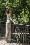 Shooting in villa ada model evening dress. Girl who is on the balcony of a private villa Royalty Free Stock Image