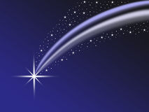 Shooting wish star with tail and star field Stock Photo