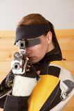 Shooting. Woman training sport shooting with air rifle gun Royalty Free Stock Photo