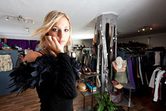 Shop. Young woman in an evening gown in a shop Stock Photos