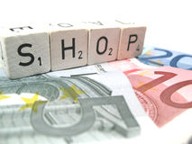 Shop. Spelled out word shop on money stock images