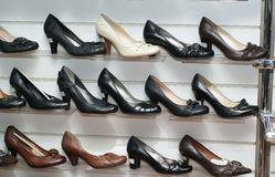 In the shop. Shelves with footwear in the shop Stock Image