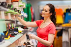 Shop assistant. Young female sportswear shop assistant working in store Stock Images