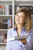 Shop assistant in the bookshop Stock Photography