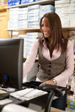 Shop assistant at cash stock images