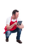 Shop assistant checking stock in supermarket. While using modern tablet for inventory on white background Stock Photography