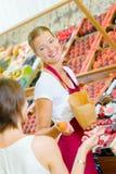 Shop assistant on fruit aisle Stock Photography