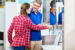 Shop assistant in hardware store counseling customer about lavat Stock Images