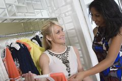 Shop Assistant Helping Customer At Clothes Shop Stock Images