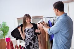The shop assistant helping woman with buying choice. Shop assistant helping women with buying choice Stock Photos