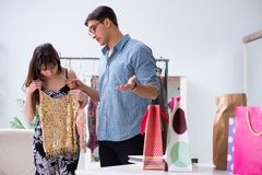 The shop assistant helping woman with buying choice. Shop assistant helping women with buying choice Stock Photography