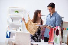 The shop assistant helping woman with buying choice. Shop assistant helping women with buying choice Royalty Free Stock Image