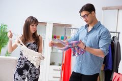 The shop assistant helping woman with buying choice. Shop assistant helping women with buying choice Stock Photo
