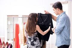 The shop assistant helping woman with buying choice. Shop assistant helping women with buying choice Stock Image