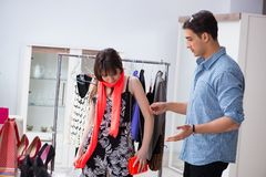 The shop assistant helping woman with buying choice. Shop assistant helping women with buying choice Royalty Free Stock Photography