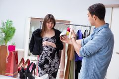 The shop assistant helping woman with buying choice. Shop assistant helping women with buying choice Royalty Free Stock Photos