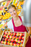 Shop assistant holding tray nectarines Royalty Free Stock Images