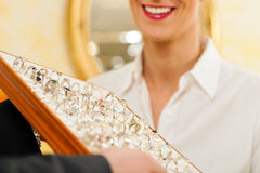 Shop assistant at the jeweller Stock Photos