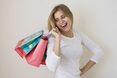 Shop assistant with multiple bags Stock Photos