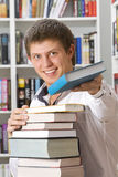 Shop assistant offer book Stock Photos