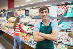 Shop assistant posing with arms crossed Royalty Free Stock Photos