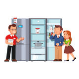 Shop assistant showing refrigerator to clients. Shop assistant seller showing single door refrigerator to clients man and woman. Domestic appliances store vector illustration
