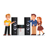Shop assistant showing stereo system to customers. Shop assistant showing three-way hi-fi stereo system floor standing tower speakers to customers family couple Stock Photo