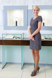 Shop assistant stands near the window case Stock Photography