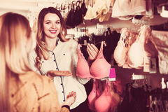 Shop assistant in underwear store Royalty Free Stock Images