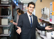 Shop assistant working with customer Royalty Free Stock Images