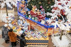 Shop assistants dressed as Snow Maidens selling Christmas decorations. MOSCOW - 30 NOVEMBER, 2017: Shop assistants dressed as Snow Maidens for Christmas sales stock images