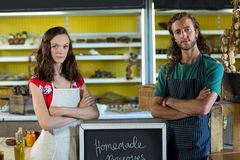 Shop assistants standing with their arms crossed. At grocery shop royalty free stock photo