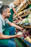 Shop assistants working together. In grocery shop royalty free stock photos