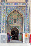 Shop in the atrium of Samarkand Registan, Uzbekistan. SAMARKAND, UZBEKISTAN - Small souvenir shop in the colorful atrium in Samarkand Registan, Uzbekistan Royalty Free Stock Images