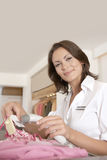 Shop Attendant at Counter Royalty Free Stock Photos