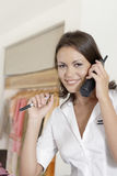 Shop Attendant on Phone Stock Image