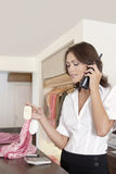 Shop Attendant on Phone Royalty Free Stock Photos