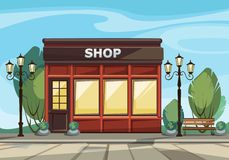 Shop Boutique Store with Windows, Greenery and Street Lanterns Stock Photo