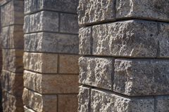 Shop with building materials. Fence post made of split face block stock photo