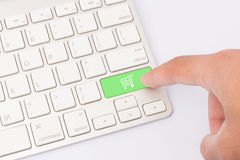 Shop cart keyboard key and finger Stock Images