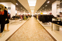 Shop of clothes, autumn clothes, collection of bag. Big shop of clothes, autumn clothes and collection of female bags royalty free stock photography
