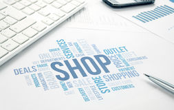 Shop concept word cloud print document, keyboard, pen and smartp Stock Photography