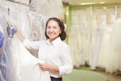 Shop consultant  at shop of wedding fashion Stock Photo
