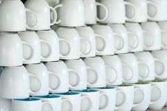 Shop counter with white cups lines Royalty Free Stock Photography