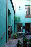 Shop courtyard in San Antonio de Areco, Argentina. A typical courtyard in a retail building in Argentina, with indoor space blending into outdoor space. Blue Royalty Free Stock Images