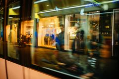Shop displays and Christmas light decorations reflected. STRASBOURG, FRANCE - NOV 21, 2017: Shop displays and Christmas light decorations reflected in tramway Royalty Free Stock Photo